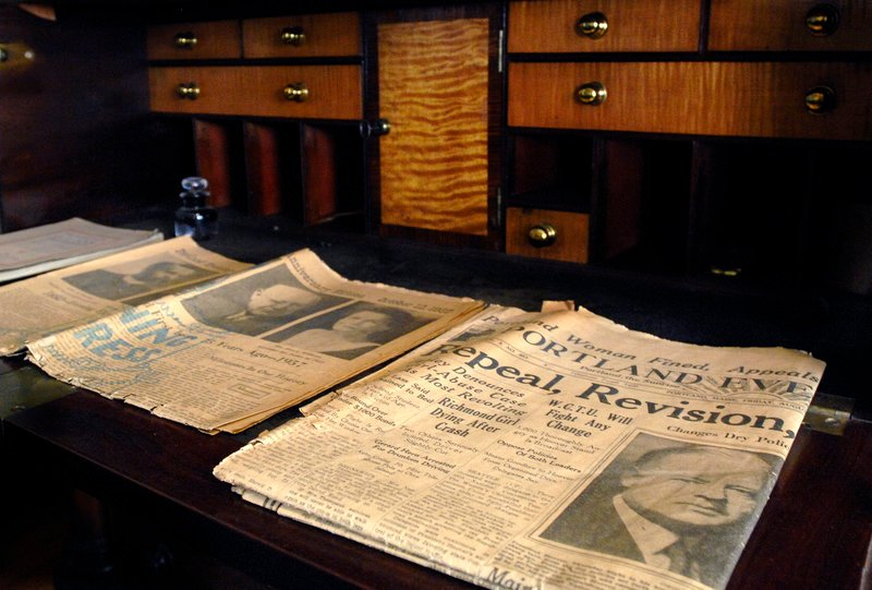 Newspapers displayed in a study at the Neal Dow House in Portland show headlines about Prohibition's repeal in 1933.
