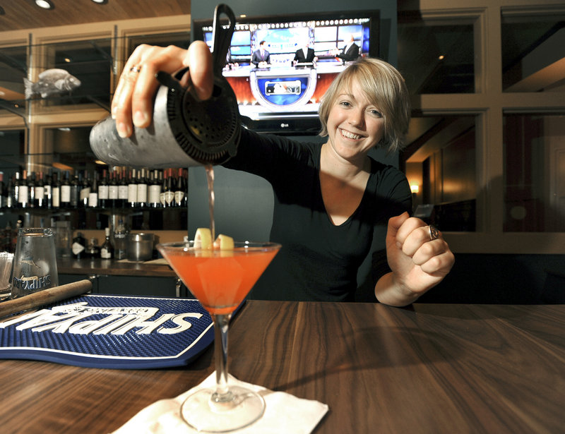 Bartender Kelly Franklin pours a strawberry basil lemonade cocktail at the Falmouth Sea Grill in Falmouth.