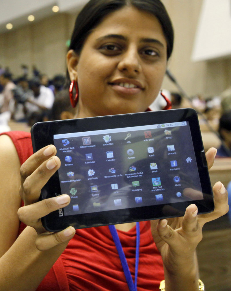 An Indian student shows off a supercheap Aakash tablet computer in New Delhi on Wednesday.