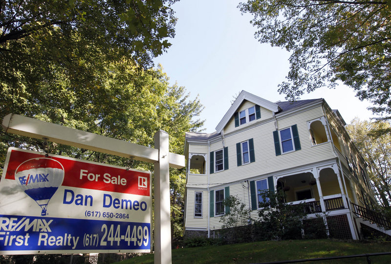 A sign advertises a home for sale last month in Newton, Mass. Even with mortgage rates among the lowest in history, buying a house is too big a risk for many Americans in the down economy.