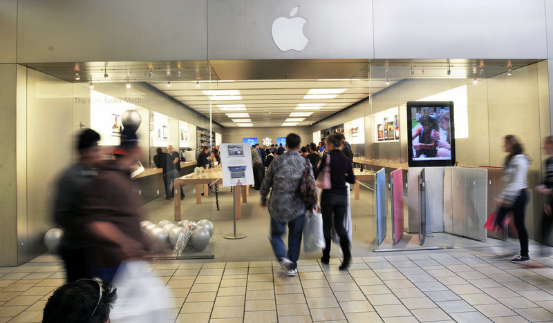 "The show goes on: Employees were ""pushing forward"" Thursday at the Maine Mall Apple store, an associate said."