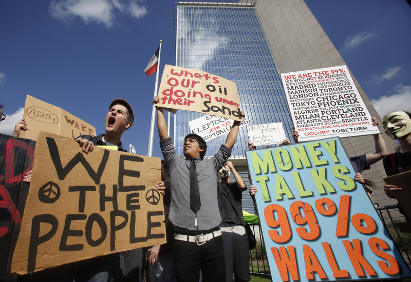 Demonstrators chant slogans Thursday outside the Federal Reserve Bank of Dallas. Rallies across the nation focused on the weak economy and corporate influence on government.