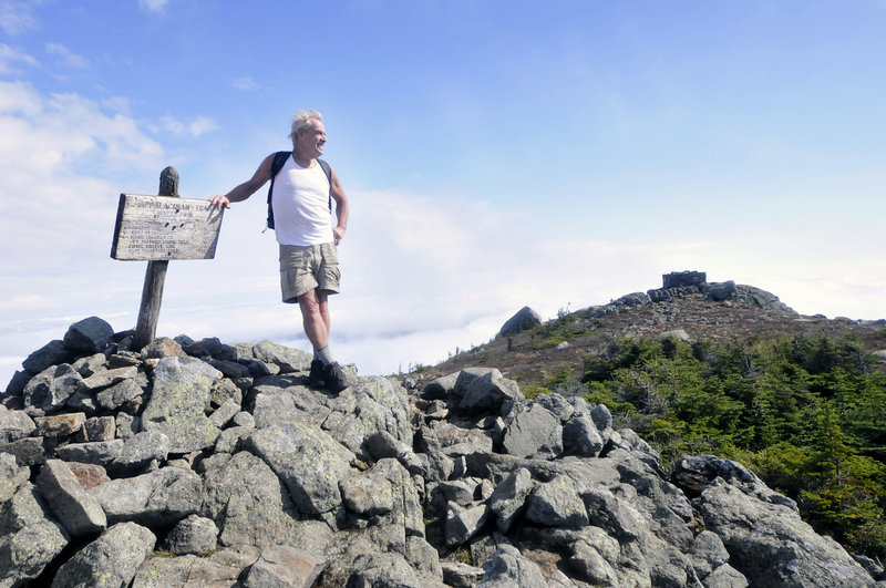 John Christie takes in the view from Avery Peak on Bigelow Mountain earlier this month.
