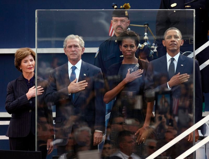 The Bushes and Obamas stand during the national anthem on the 10th anniversary of 9/11.