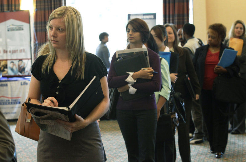 Annelie Ingvarsson, left, waits in line to talk to potential employers during a National Career Fairs job fair in Bellevue, Wash., last month. The United States added 103,000 jobs in September, an improvement over this summer and just enough to calm fears of a new recession that have hung over Wall Street and the nation for weeks.