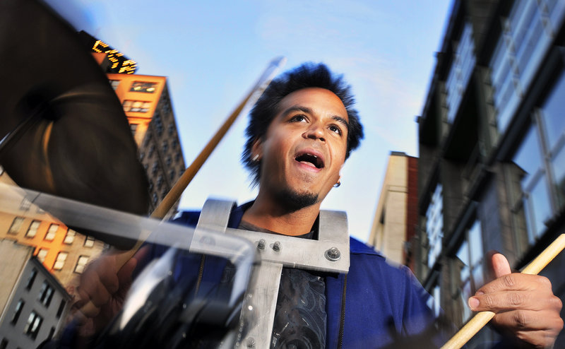 Sunny Jain, a drummer with the New York City-based Asphalt Orchestra, leads the group up Congress Street from Monument Square to Longfellow Square during October's First Friday Art Walk.