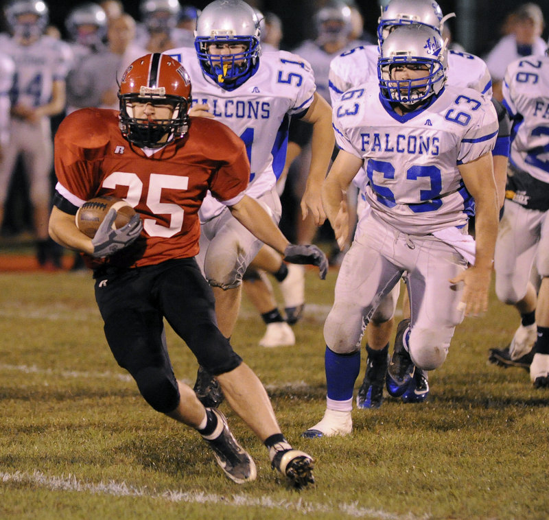 Doug McLean of Wells has the ball and an opening Friday night with the Mountain Valley defense giving chase. Mountain Valley was doing the chasing for most of the game but never caught up as the Warriors remained undefeated with a 28-12 victory.
