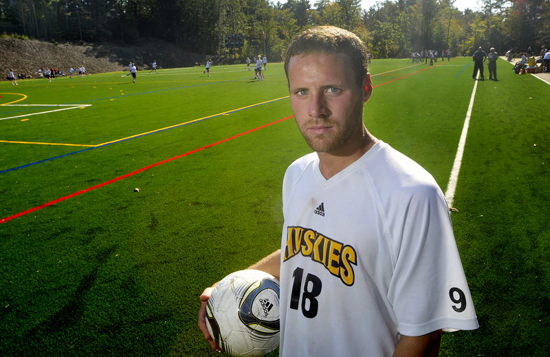 Jeff Soules has had to handle more than most college captains, dealing with his own grief while lifting the University of Southern Maine men's soccer team following a teammate's suicide. Team members wear Buddy Reid's No. 9 on their sleeves.