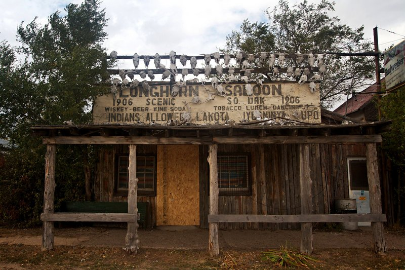 The Longhorn Saloon, adorned with cattle skulls and marked with the building's founding date of 1906, is among the properties included when the town of Scenic, S.D., was sold to a Filipino church whose intentions aren't known to locals.