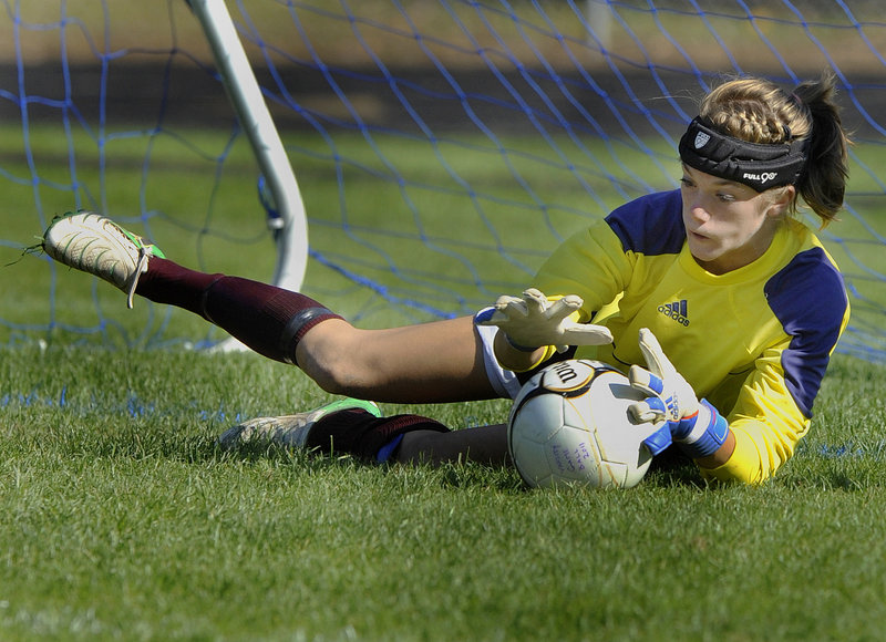 Gorham goalkeeper Sarah Perkins dives to make a save on a Kennebunk shot in the second half Monday during unbeaten Gorham's 6-0 victory in a Southern Maine Activities Association schoolgirl soccer game.