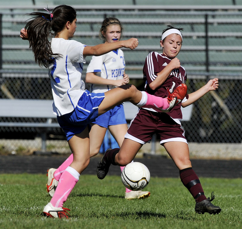 Caroline Hoch of Kennebunk, left, attempts to break up the play Monday as Allie Lurvey of Gorham looks to drive the ball down the field during Gorham's 6-0 victory in an SMAA schoolgirl soccer game.