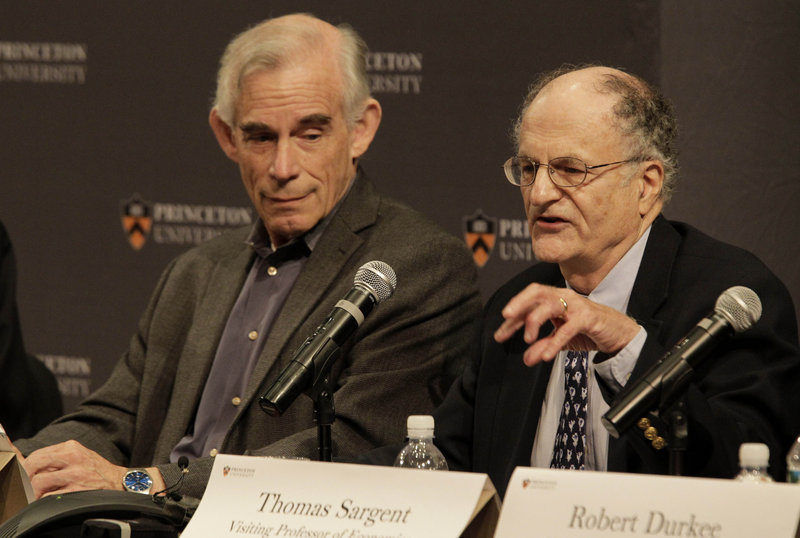 Christopher Sims, left, listens as Thomas Sargent talks about winning the Nobel Prize on Monday in Princeton, N.J.
