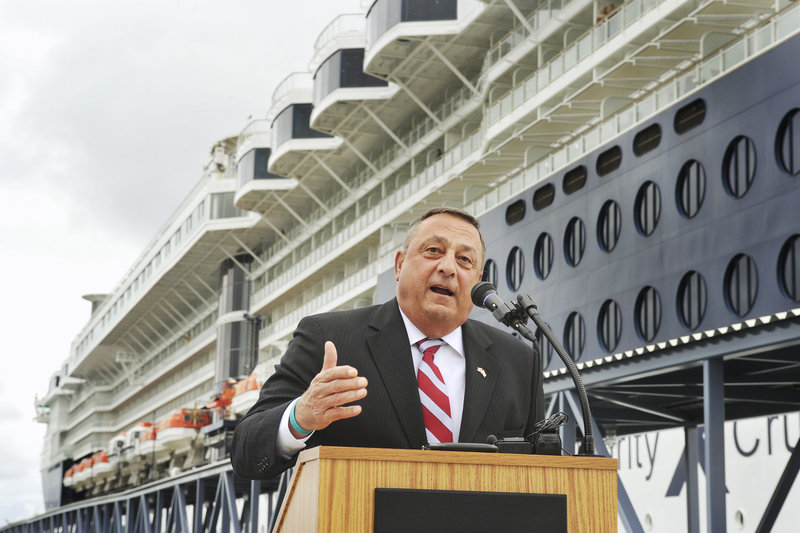 Gov. Paul LePage addresses a gathering at the official opening of the Ocean Gateway Pier II in Portland on Wednesday. The Celebrity Summit cruise ship is in the background.