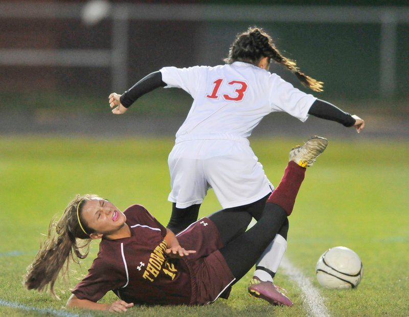 Amanda Arnold of Thornton Academy hits the ground Wednesday night after getting tangled with Anh Nguyen of South Portland. Arnold scored twice as Thornton improved to 10-1-1 with a 4-0 victory at South Portland.