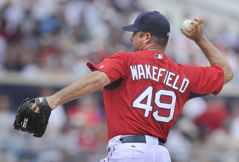 Red Sox pitcher Tim Wakefield (shown in an exhibition game last April) and all his teammates couldn't get Boston into the playoffs this year, laments a reader.