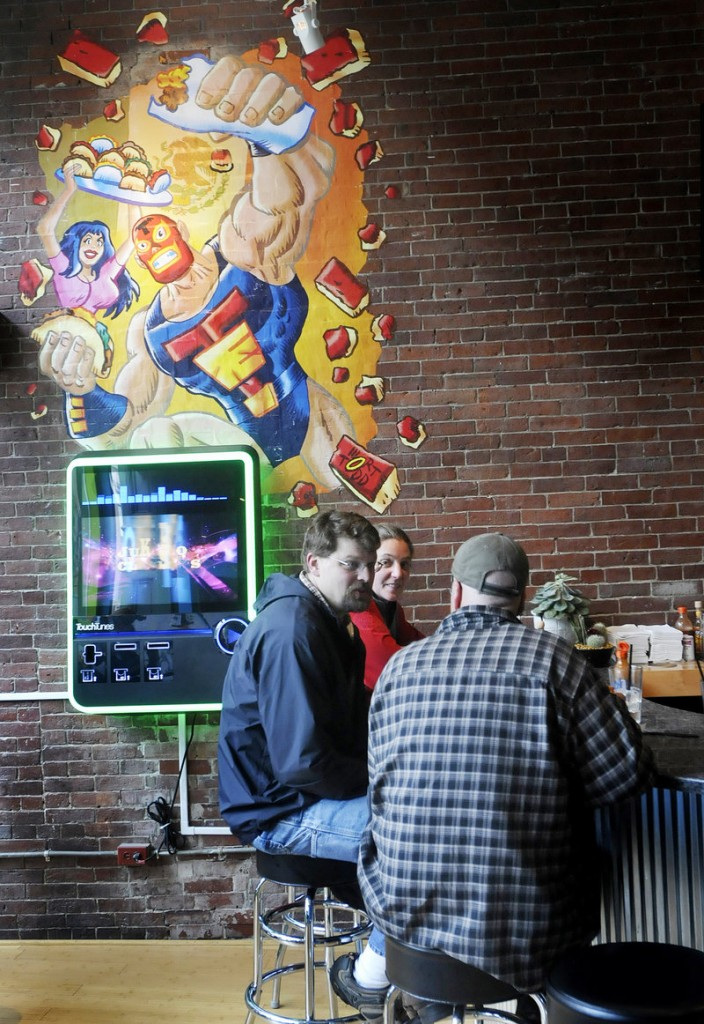 Patrons enjoy the atmosphere and food at Taco Escobarr in Portland.