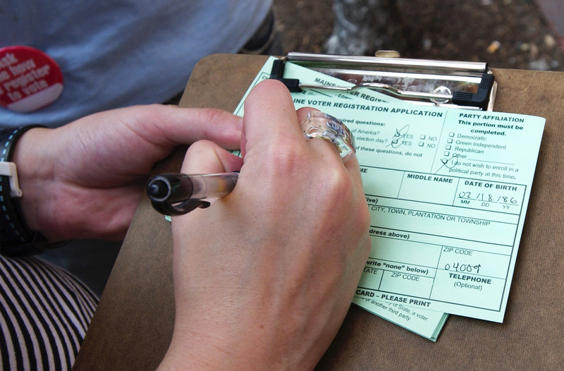 Filling out a registration card should be an option up to Election Day, readers say.