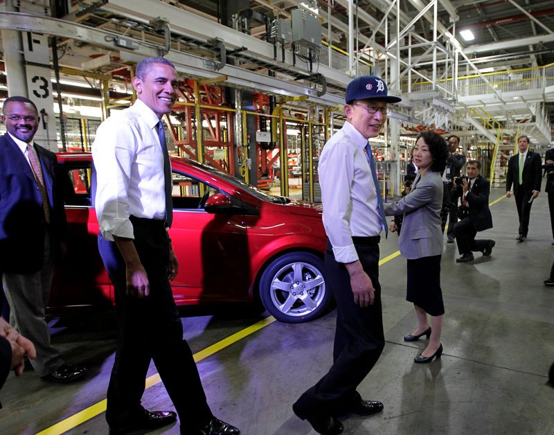 President Barack Obama and South Korean President Lee Myung-bak, wearing a Detroit Tigers baseball cap, tour the General Motors Orion Assembly Plant in Orion Township, Mich., on Friday to promote the free-trade agreement between Washington and Seoul that was passed by Congress last week. The GM operation is a U.S. and South Korean collaboration where the subcompact Chevrolet Sonic is produced. The agreement with South Korea also could help open doors to more trade with China and Japan.