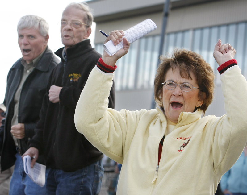 Judy Ambrose of Falmouth cheers for her son, driver Michael Graffam, as he drives Riot Act in a 1-mile trot.