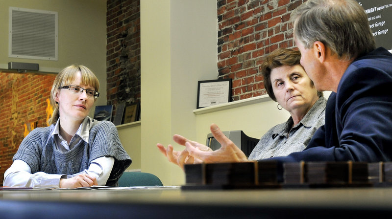 """Anastasia Bogdanova, left, meets with City Councilor Ed Suslovic and Janis M. Beitzer, executive director of Portland's Downtown District. Bogdanova liked Portland's employee recognition programs. """"Where I'm from, it's work, work, work: no recognition,"""" she said."""