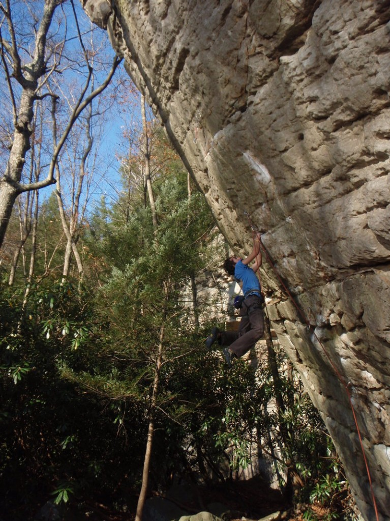 Maine Rock Gym manager, instructor and coach Chuck Curry climbs a rock face.