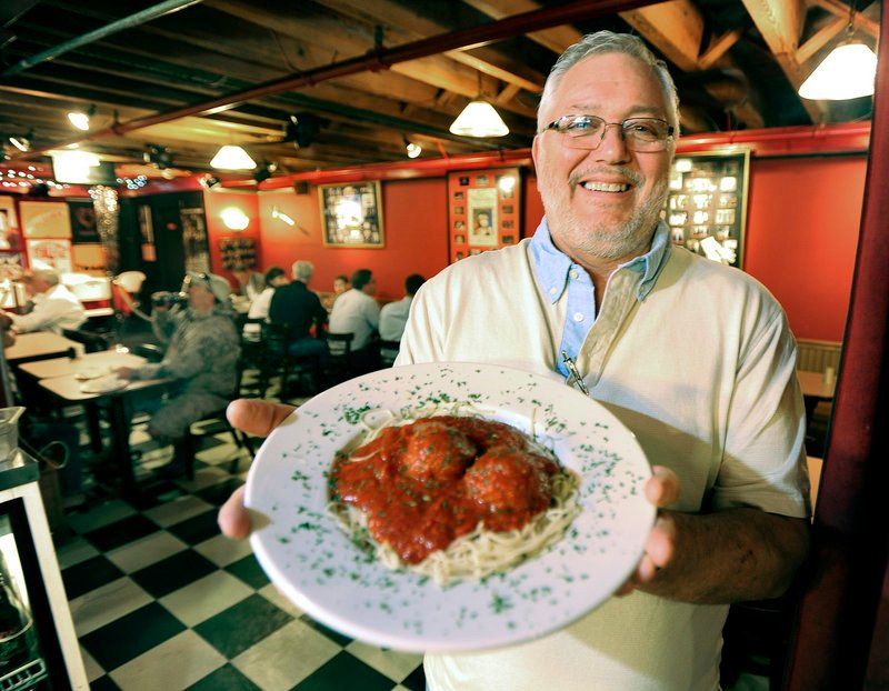 Anthony Barrasso, owner of Anthony's Italian Kitchen in Portland, holds a heaping plate of his fourth-generation homemade meatballs nestled on spaghetti and covered with Italian gravy.