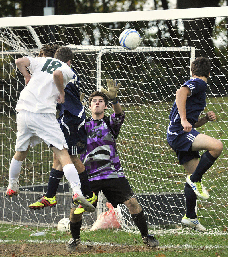 Photos by John Ewing/Staff Photographer Waynflete's William Cleaves gets a header off a corner kick headed toward the Fryeburg goal on Monday but the shot went wide of the net. Fryeburg took a 4-0 win as Waynflete lost its first game of the season.