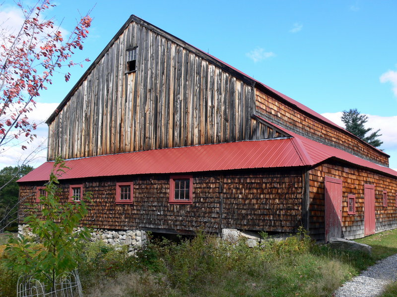 This Sebago barn was lengthened, nearly doubling its footprint, before receiving several lean-to-like additions.