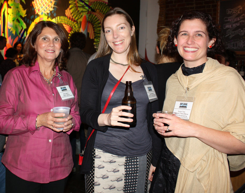 Board members Mary Marsh of the Marsh Agency and co-chair of the event; Stacy Mitchell of the Institute of Local Self-Reliance; and Susan Tran of Tsunami Tattoo and Maine Public Broadcasting.