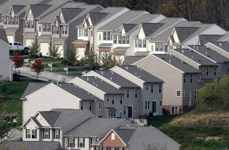 """New homes wind across a hillside in Canonsburg, Pa. Homebuilding increased in September, but the number of Americans who bought previously occupied homes fell. """"This is a significant barrier to recovery,"""" says Ian Shepherdson of High Frequency Economics."""