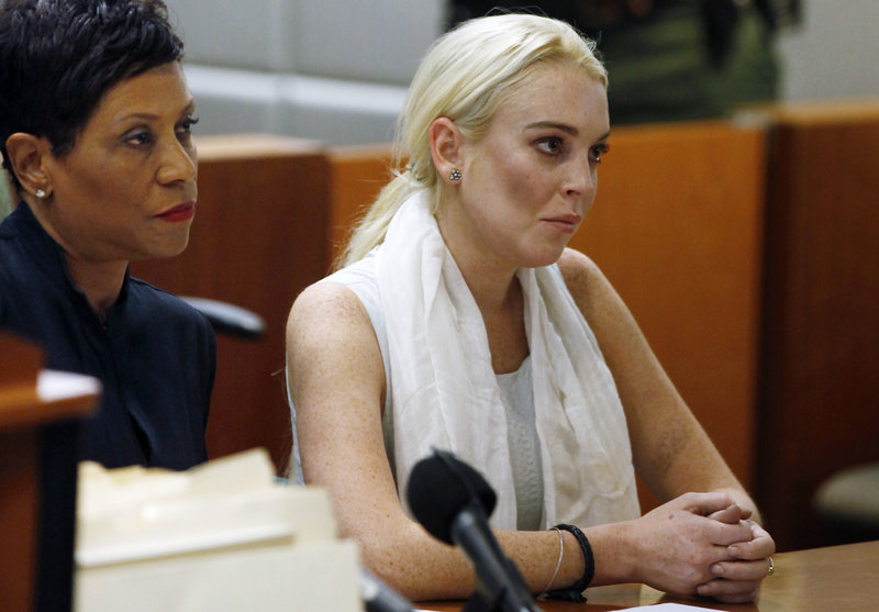 Lindsay Lohan appears in court Wednesday before she was taken into custody by Los Angeles County sheriffs deputies.