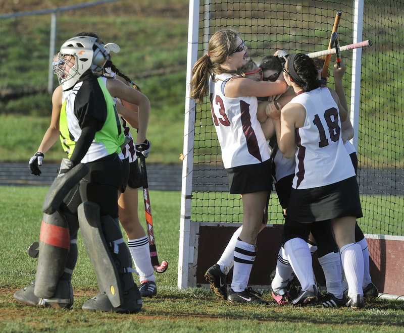 Leavitt goalie Taylor Eells walks away Thursday as Julia Maine is hugged after scoring the goal that gave Greely a 1-0 victory.