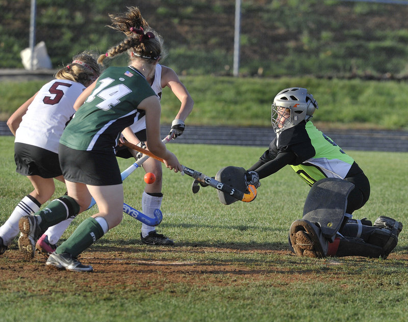 aylor Eells, the goalie for Leavitt, moves out to block a Greely scoring attempt Thursday during Greely's 1-0 victory in a Western Class B field hockey quarterfinal.