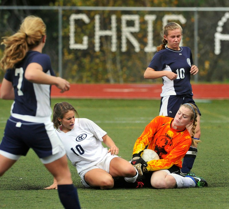 Fryeburg Academy goalie Maggie McConkey holds on to the ball during a collision with Yarmouth's Tess Merrill in a Western Class B girls' soccer prelim Friday. Yarmouth advanced to the quarterfinals.