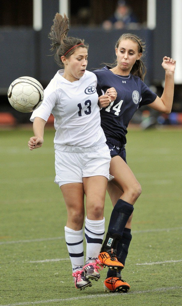 Mo McNaboe, left, of Yarmouth and Fryeburg Academy's Sydney Charles contend for a loose ball in a girls' soccer prelim.