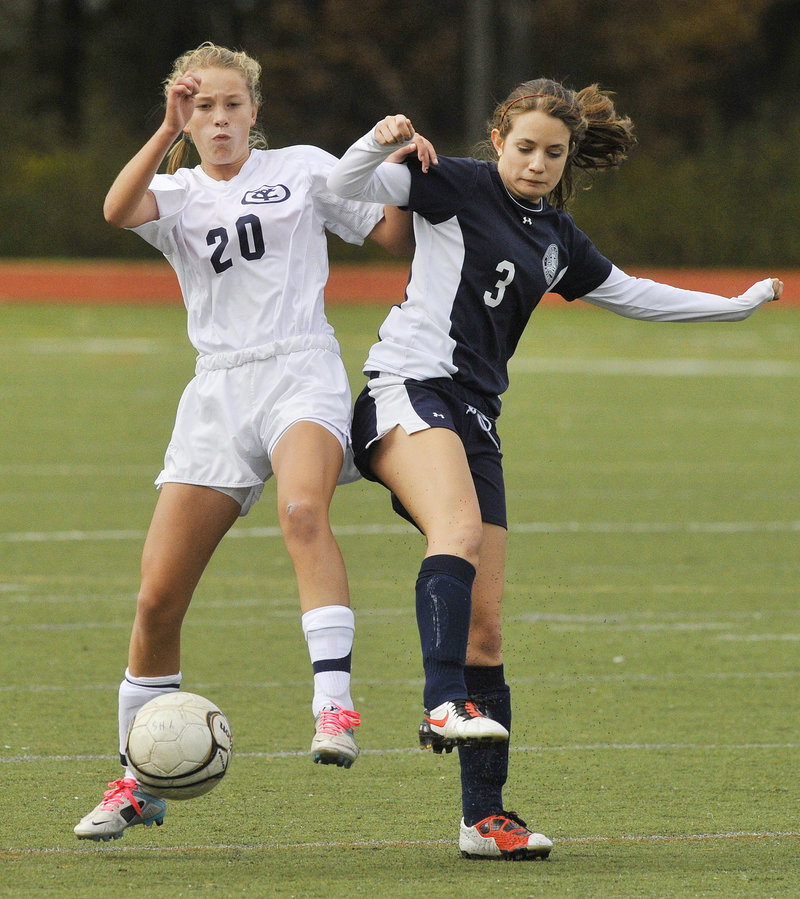 Emma Torres, left, of Yarmouth and Kallie Moulton of Fryeburg Academy try to gain control of a loose ball. Yarmouth will play No. 3 Falmouth in the quarterfinals on Tuesday.