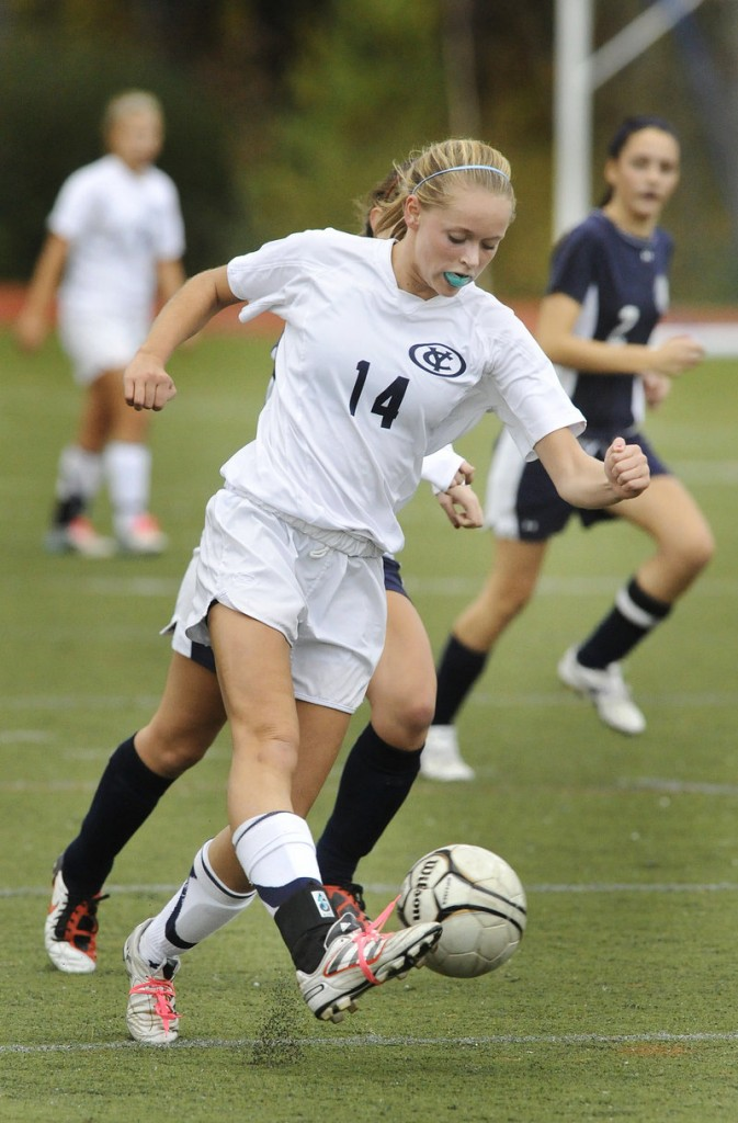 Ariel Potter of Yarmouth stays ahead of a defender and delivers a shot. Potter had the Clippers' first goal in a 3-0 victory.