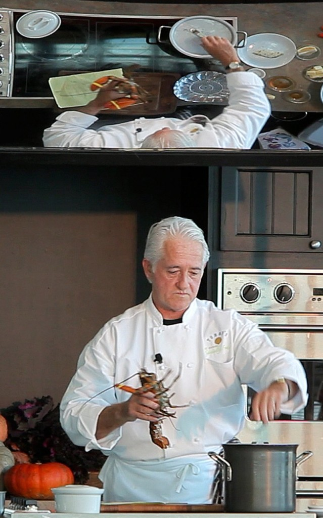 Thomas Reagan, a personal chef from Kennebunk, prepares Slow Poached Maine Lobster Tail Nipponese during the Maine Lobster Chef of the Year competition at the Harvest on the Harbor festival in Portland on Friday. He won the competition with the dish that fused Maine and Asian flavors.