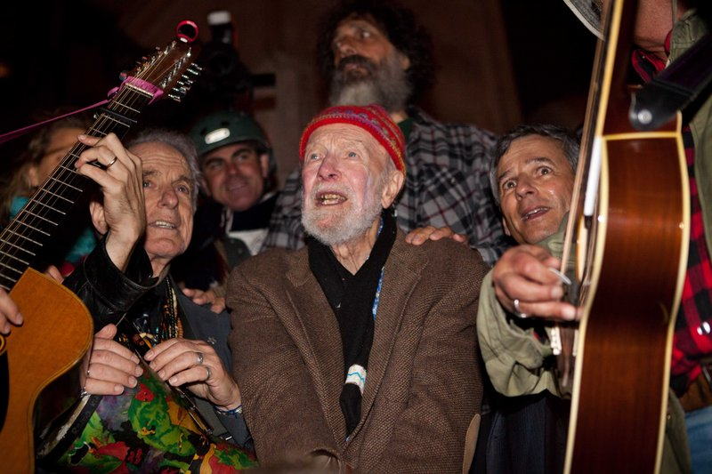 Activist musician Pete Seeger, 92, center, sings before nearly 1,000 people sympathetic to the Occupy Wall Street protests at a brief acoustic concert in New York on Friday.