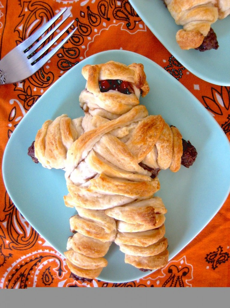 "Maggie da Silva's ""meatloaf mummy,"" wrapped in strips of biscuit dough, fixes its eater with a baleful red (ketchup-y) glare."