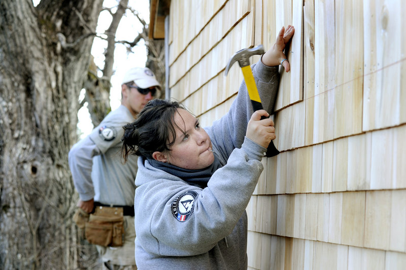 Paul Logan and Maria Browning are part of the AmeriCorps crew that is building a replica privy shed. The team is splitting its time between the privy and a Habitat for Humanity project.