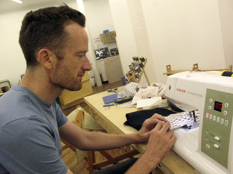 Sean O'Driscoll fixes his pants pockets at the Brooklyn chapter of Sewing Rebellion in New York.