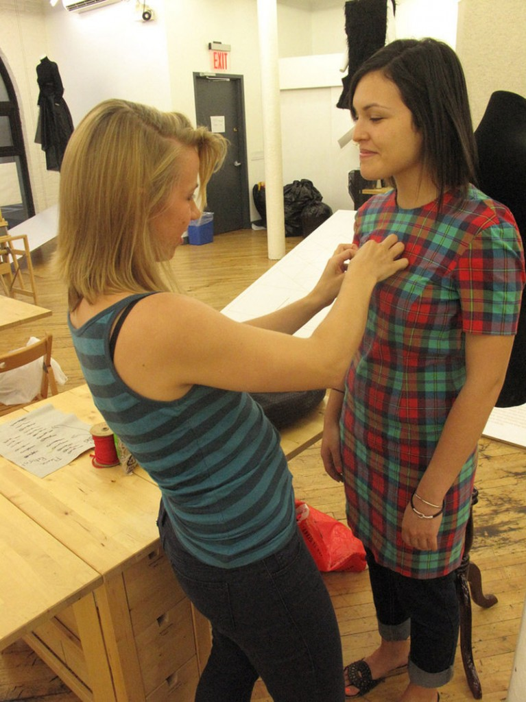Mariel Zook, left, redesigns an old dress with Mimi Galvez. Sewing Rebellion offers instruction for all skill levels.