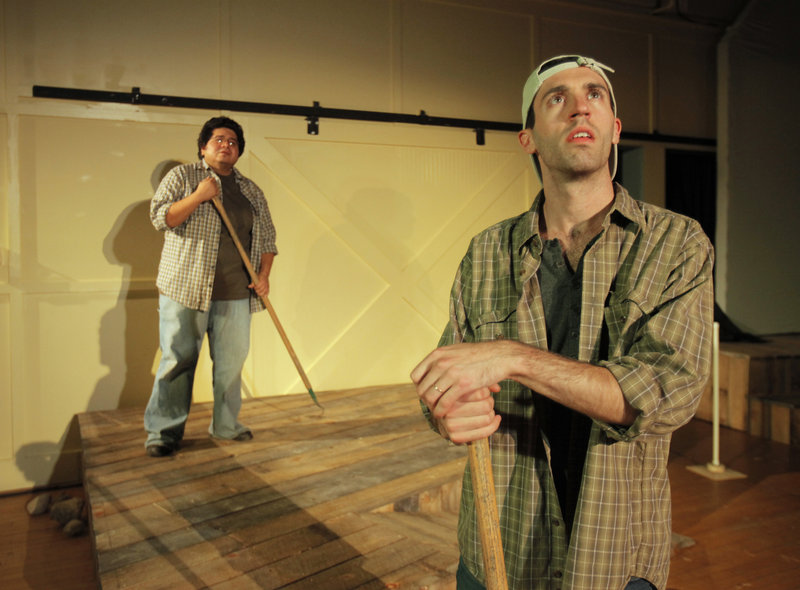 """Jae Rodriguez, left, and Chris Reiling, two of the actors in """"Farms and Fables,"""" rehearse a scene Wednesday at Camp Ketcha in Scarborough. The play was conceived by Jennie Hahn and written by Cory Tamler, utilizing hands-on experience at several farms."""