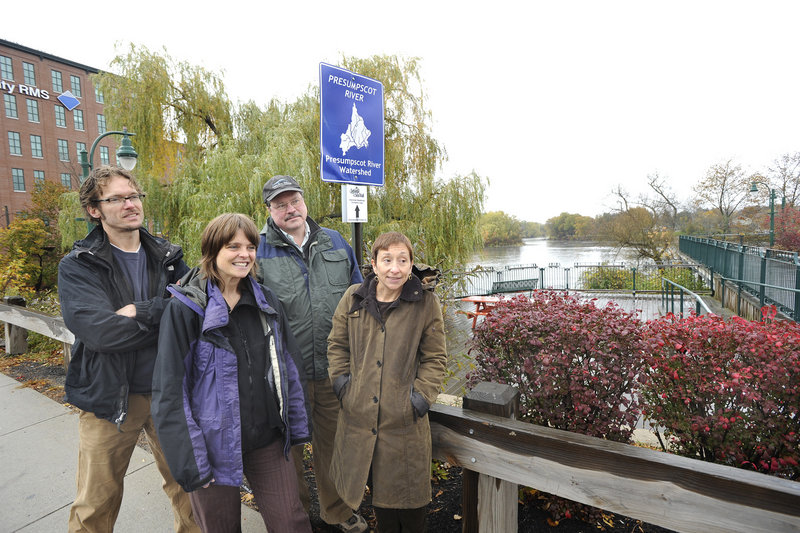 Organizers of the Sebago to the Sea Trail gather by a trail sign in Westbrook this week. They are, from left, Peter Burke of the Westbrook Recreation and Conservation Commission; Tania Neuschafer, project coordinator for the trail; Will Plumley, chairman of the Presumpscot River Watershed Coalition; and Nan Cumming, executive director of Portland Trails.