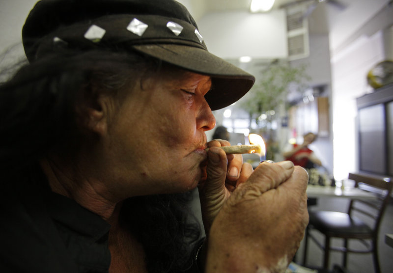 Susan Recht smokes a joint at the San Francisco Medical Cannabis Clinic. The California Medical Association has endorsed decriminalizing recreational pot use for adults.