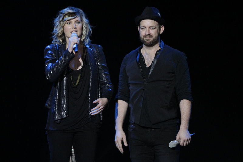 Sugarland's Jennifer Nettles, left, and Kristian Bush talk to the crowd in Indianapolis before a tribute to victims of a stage collapse at the Indiana State fair last August.