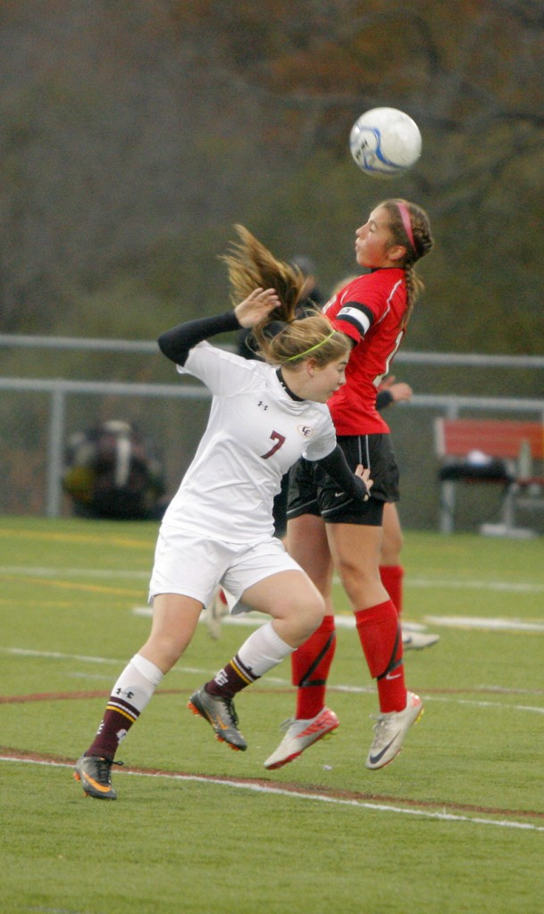 Cape Elizabeth's Melanie Vangel, left, and Scarborough's Jessica Broadhurst fight for the ball Saturday. The Red Storm move on to the regional final at Gorham.
