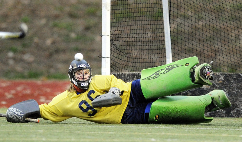 Belfast goalie Julia Ward keeps her eye on the ball while stretching to make a save Saturday during the 2-1 victory against York in the Class B field hockey championship game at Yarmouth. The Lions had to rally after York scored the first goal of the game.