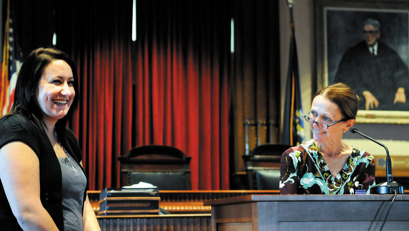 Nichole Rogers, left, laughs as Kennebec County Superior Court Justice Nancy Mills recognizes her last week during a graduation ceremony in Augusta for the Co-Occurring Disorders Court. After being charged with several crimes, Rogers, of Augusta, was enrolled in the program for two years to seek assistance for mental health and substance abuse problems.